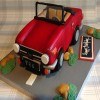TR6 Car Novelty Cake from £165