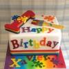 Rainbow Themed Basic Celebration Cake with rainbow sponge from £140, feeds 70+